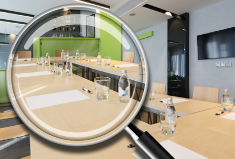 magnifying glass over meeting room